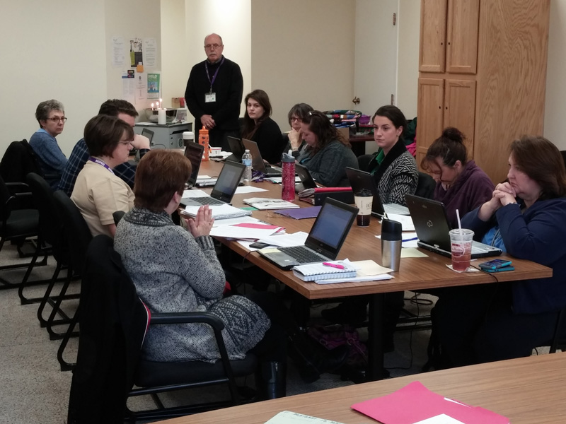 Hospice team members eulogize their patients at a recent interdisciplinary team meeting